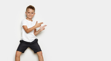 Mock up of young kid showing some action on the white background
