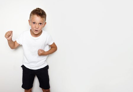 funny boy: Mockup of young hooligan showing some angry emotion on the white background
