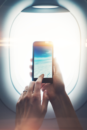 clouds making: Mockup of girl handing smartphone in hands and making photo of clouds Stock Photo