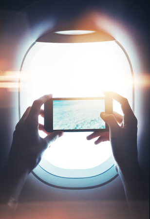 private cloud: Mock up of smart phone in female hand, with visual effects, private jet.