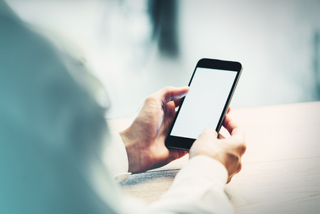 Smartphone holding in female hands and looking some info Stock Photo