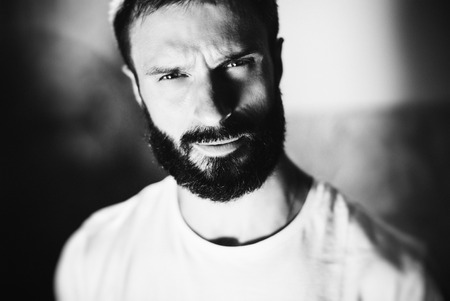 looking good: Black and white portrait of a handsome bearded man wearing white tshirt and looking good