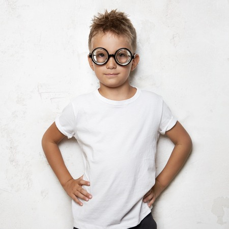 funny boy: Young boy wearing white tshirt and funny sunglasses