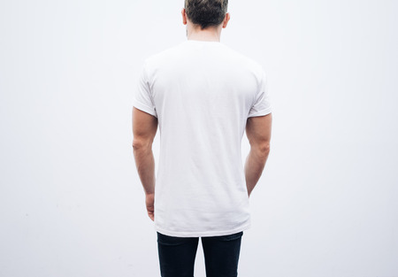 jeans: Man wearing blank tshirt and blue jeans on a white background