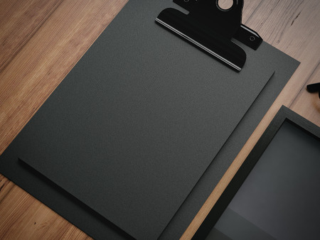black boards: Set of black branding elements on a brown wooden table on a background