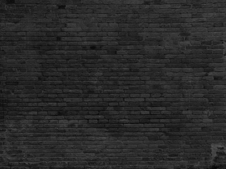 Part of black painted brick wall, horizont.