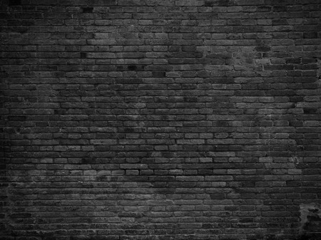 black stones: Part of black painted brick wall, horizontal