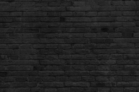 Une partie de noir mur de briques peintes, horizontal. Banque d'images