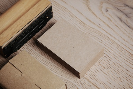 blank template: Blank business cards of kraft paper. Set of blank office elements on the wooden background