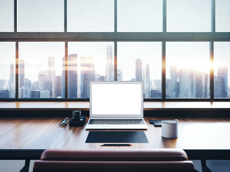 panoramic windows: Photo of generic design computer screen and workspace in loft with panoramic windows and city on the background