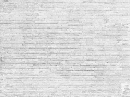 Een deel van wit geschilderde bakstenen muur, horizontaal