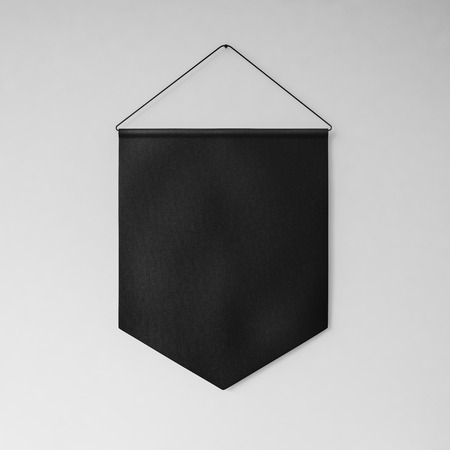 object: Black pennant hanging on the wall on gray background. Square Stock Photo