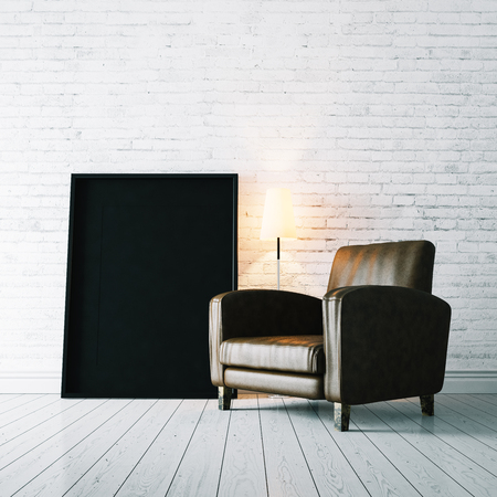 bricks background: Black blank frame on the white wooden floor and vintage armchair. White bricks wall on the background Stock Photo