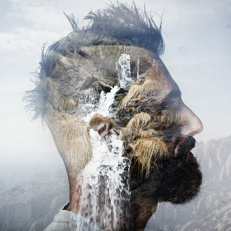 Double exposure portrait of a savage and a mountain