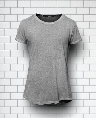briks: Dark grey tshirt isolated on the white bricks wall Stock Photo
