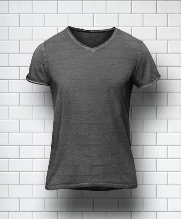 briks: Dark tshirt isolated on the white bricks wall