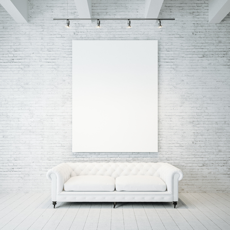 Blank white canvas and vintage classic sofa against the brick wall background. Vertical 免版税图像
