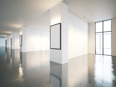 Empty white gallery interior with concrete floor and panoramic windows Reklamní fotografie