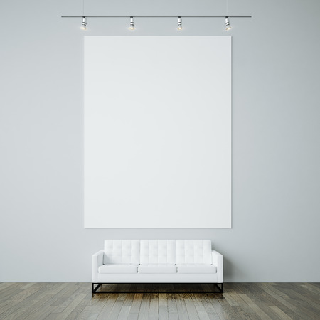 Blank White Canvas And Generic Design Sofa On The Gray Wall Background.  Vertical Stock Photo