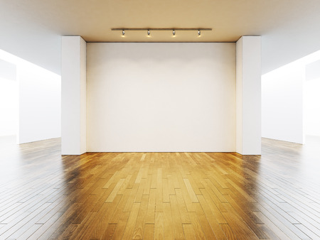 White gallery interior with empty walls and wooden floor.