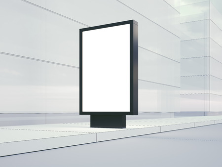 Blank lightbox on the empty street. Glass facades of buildings in  background.