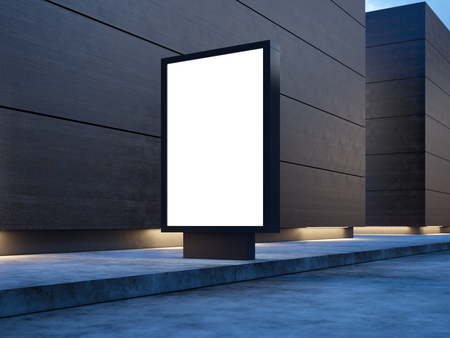 Black lightbox on the empty street. Wooden facades of modern buildings in background.