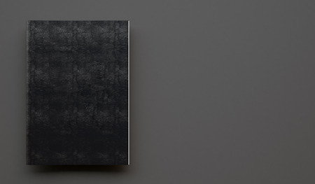 bookcover: Notebook with black leather cover on the gray background.  Horizontal
