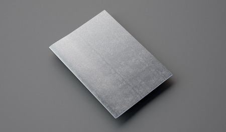 bookcover: Notebook with leather cover on the gray background.  Horizontal