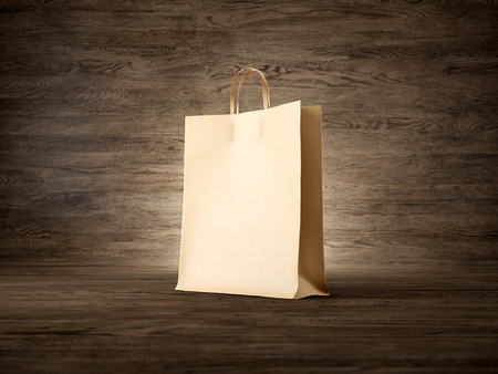 Craft shopping bag on the wooden background. Focus on the shopping bag. Horizontal