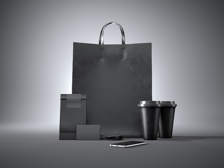 banner craft: Set of black shopping bag, two coffee cups, black business cards and generic design smartphone. Dark background