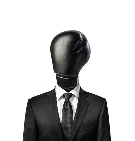 Concept of business man with boxing glove instead of the head. White wall on background. Vertical