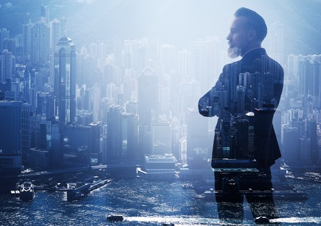 Double exposure photo of a businessman and modern city. Horizontal Stock Photo