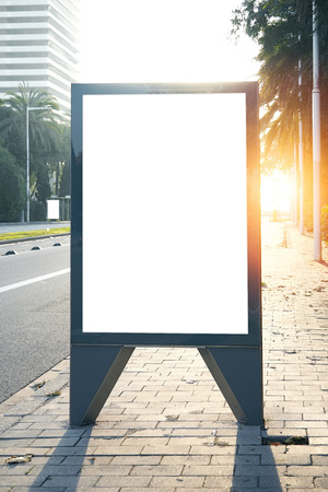 Empty lightbox on the street of the city. Blank background. Vertical
