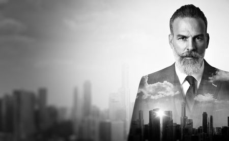 Close-up portrait of businessman. Double exposure photo of panoramic city view at sunrise Stok Fotoğraf - 50792460