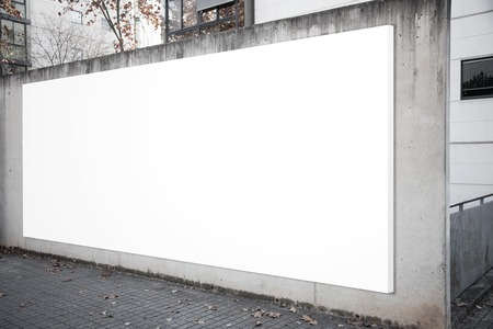 billboard advertising: Empty billboard screen on the concrete gray background.  Horizontal