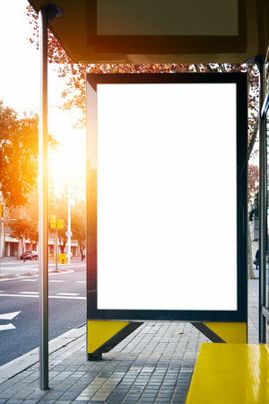 lightbox: Blank lightbox on the street of the city. Sunlights on the background