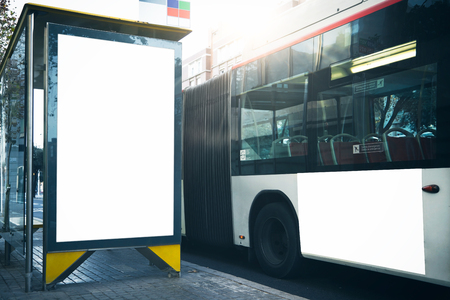 bus background: Empty lightbox on the bus stop in center of city. Visual effects Stock Photo