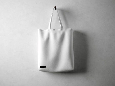 linen fabric: White and blank cotton textile bag holding, neutral background. horizontal Stock Photo