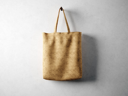 white canvas: Blank cotton textile bag holding, neutral background. horizontal
