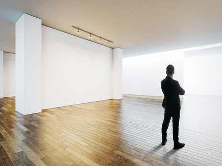 Businessman Stands Opposite Blank Frames In Contemporary Gallery ...