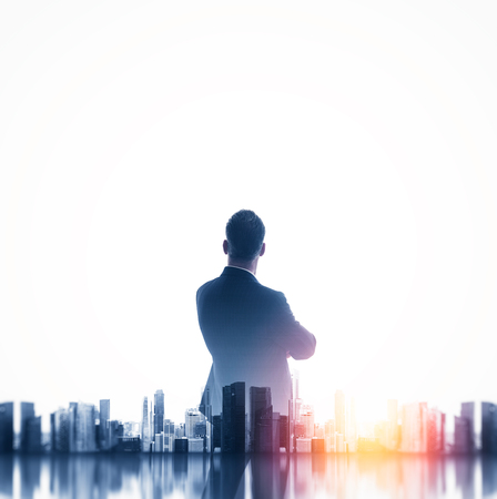 Buesinessman wearing classic suit and looking cityscape. Double exposure. Square