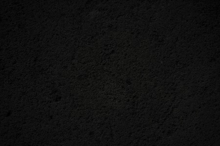 Highly detailed and empty black concrete wall. Horizontal