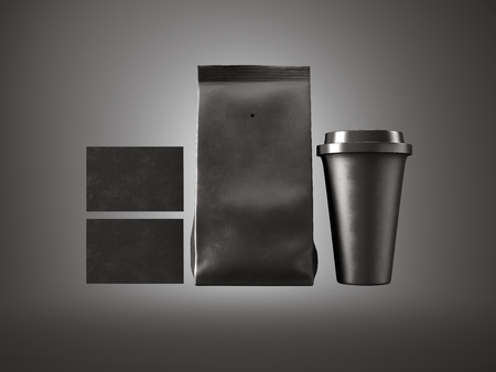 plactic: Set of black paper package, coffee cup and two blank business card. Black background, front view. Stock Photo