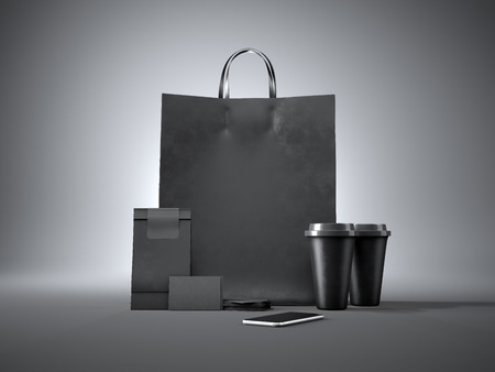 paper bag: Set of black shopping bag, two coffee cups, paper package, black business cards and generic design smartphone. Gray background