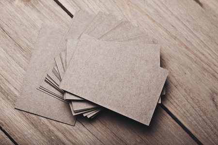 wood craft: Photo of blank and craft business cards on natural wood table. Horizontal