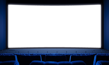 Movie theater with empty seats and big white screen.