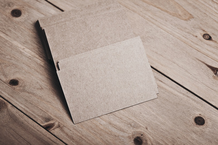 wood craft: Blank and craft business cards on natural wood table. Horizontal