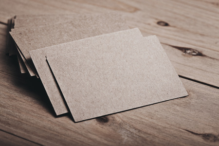 wood craft: Closeup of blank and craft business cards on natural wood table. Horizontal. Color.