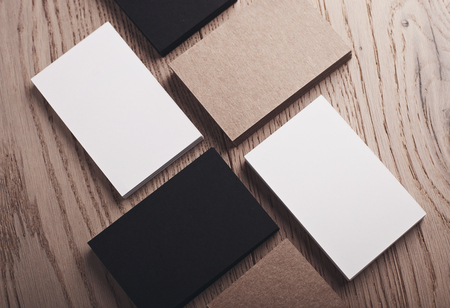 wood craft: Closeup of white, black and craft business cards on natural wood table. Horizontal