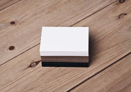 wood craft: Photo of white, black and craft business cards on natural wood table. Horizontal Stock Photo